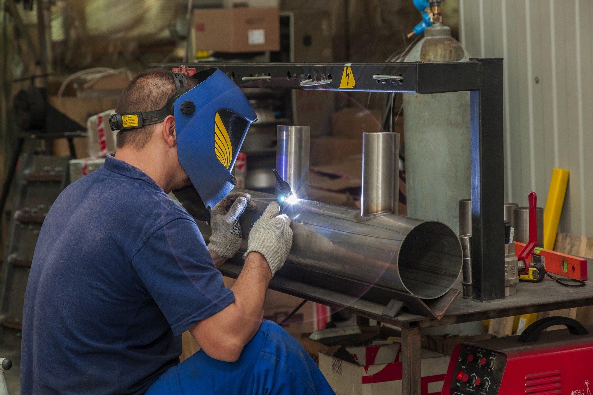 Welder welding stainless steel