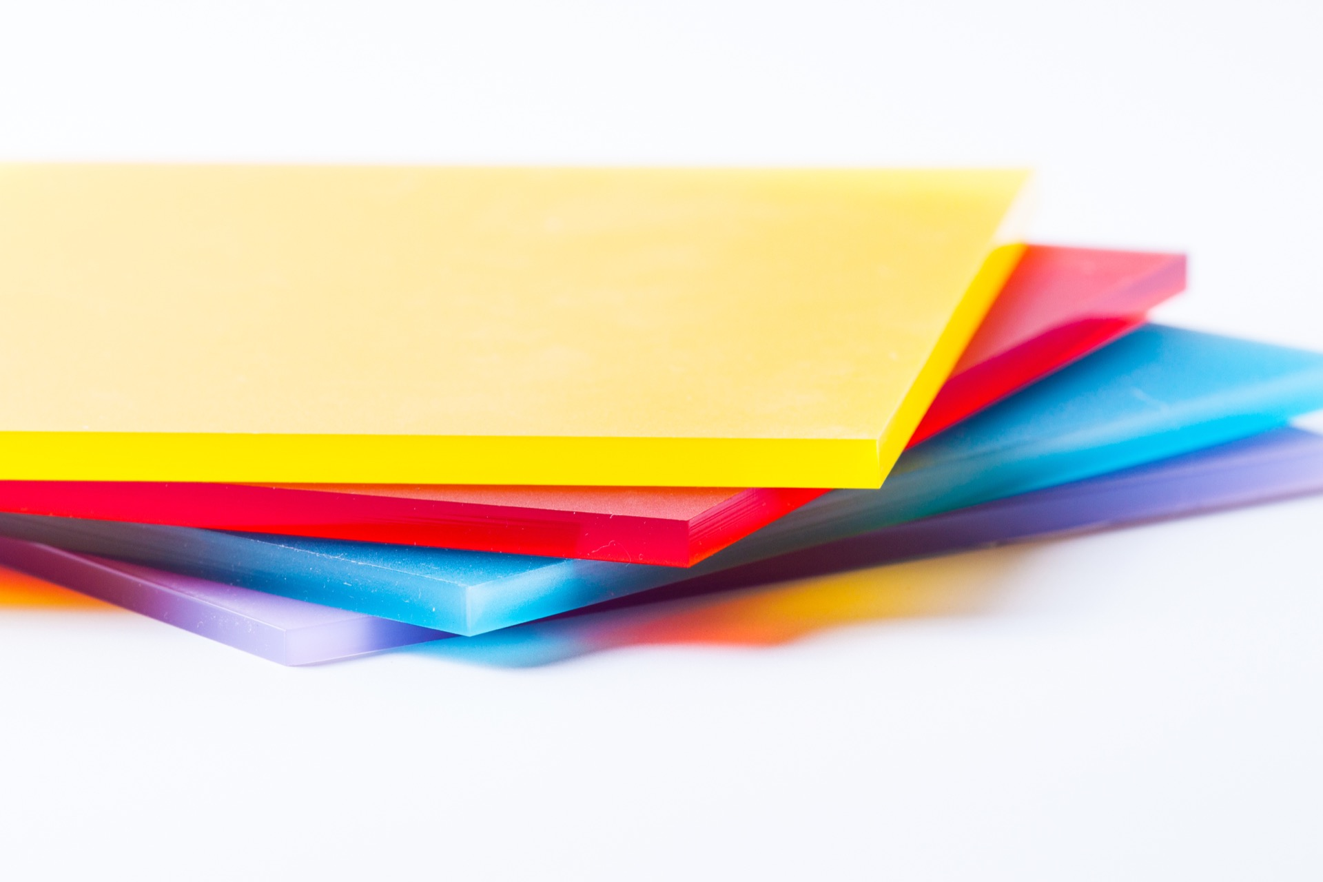 Sheets of coloured acrylic plastic